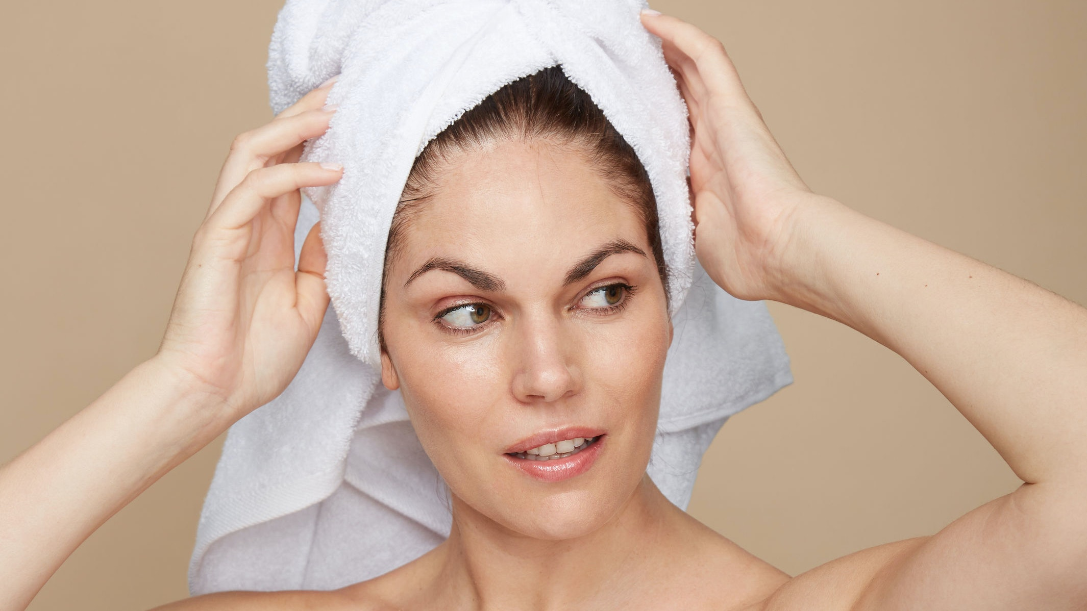 Woman Putting A Towel On Her Head After Shower
