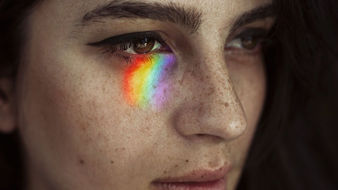 Woman with rainbow under eyes