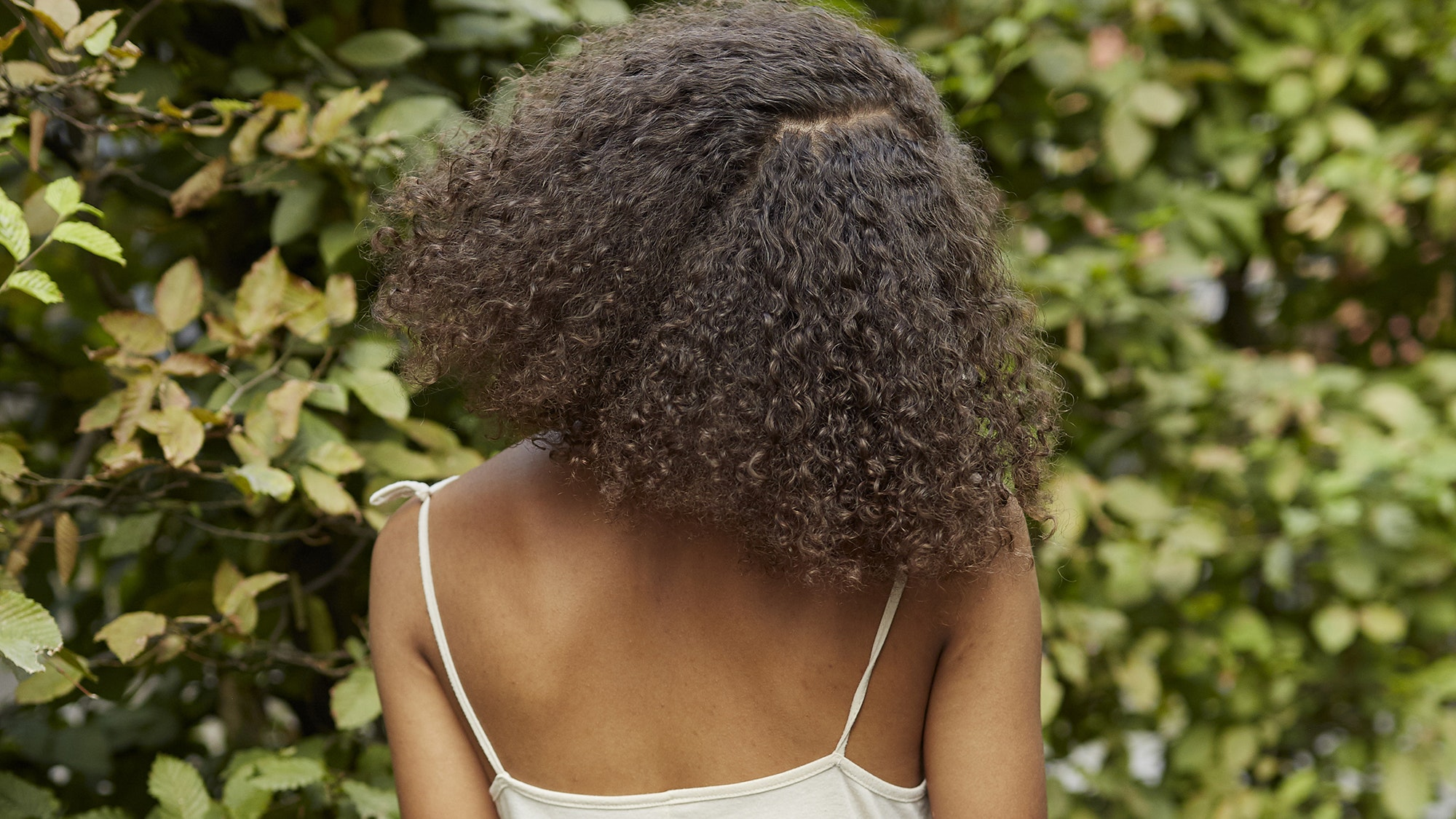 7 Tips That Will Help Curly Hair Conquer Frizz All Year Long