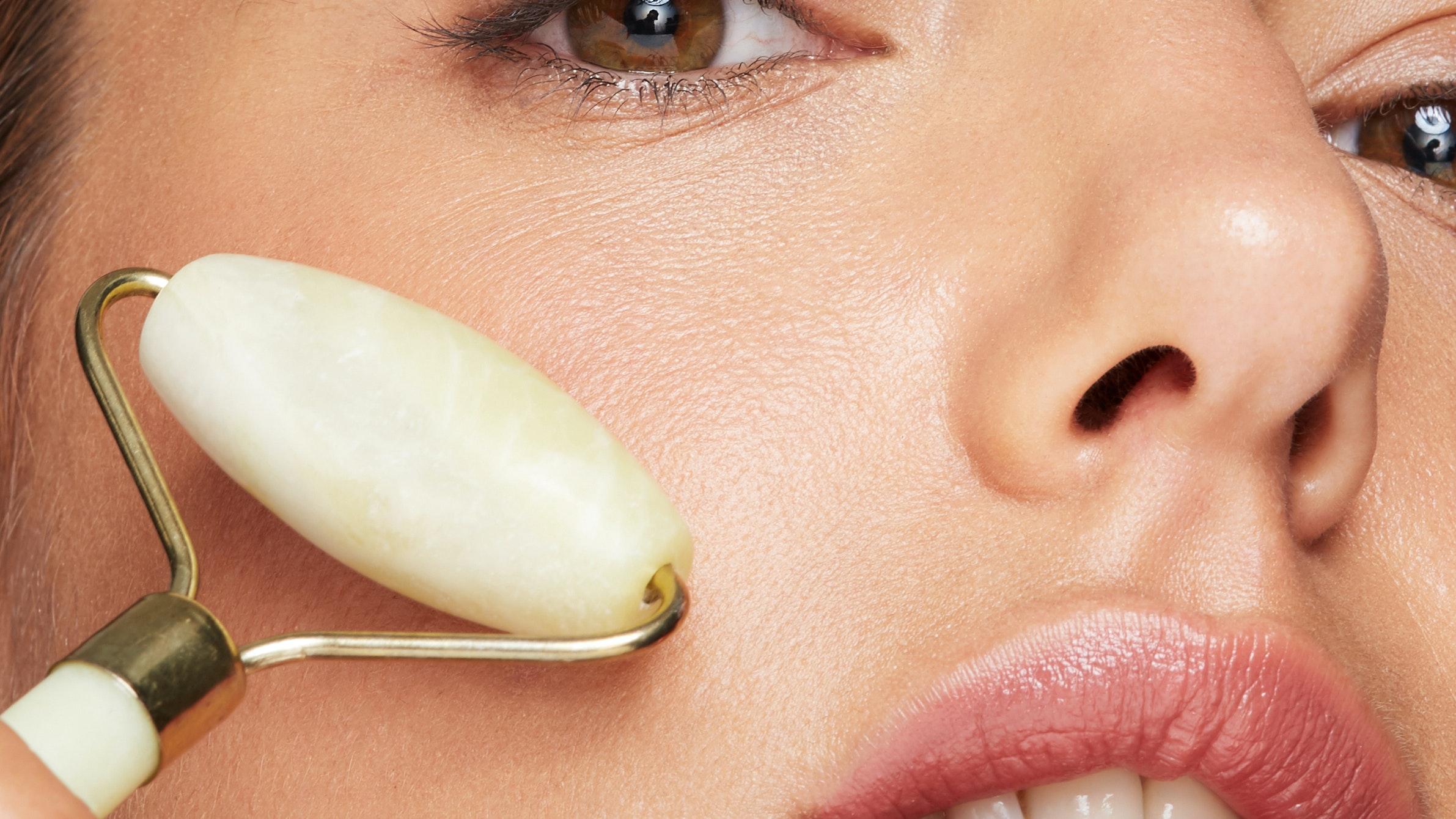 Beauty Shot - Woman Using Jade Roller Closeup - Fresh Bronze Skin Care Massage