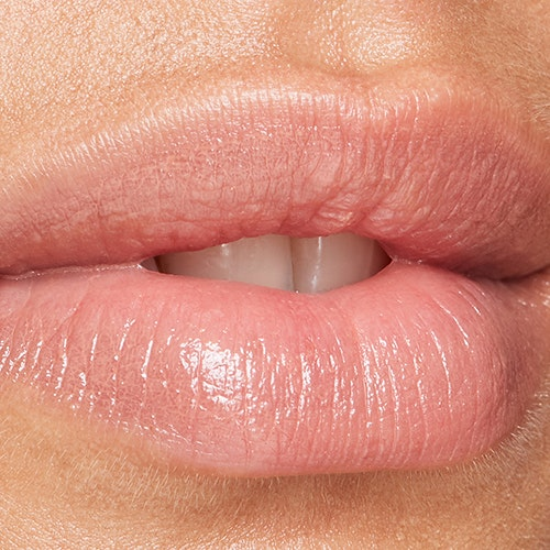 Make Your Lips Look Fuller, Smooth Lines Around Your Mouth, & More Lip Tricks From Derms & Makeup Artists