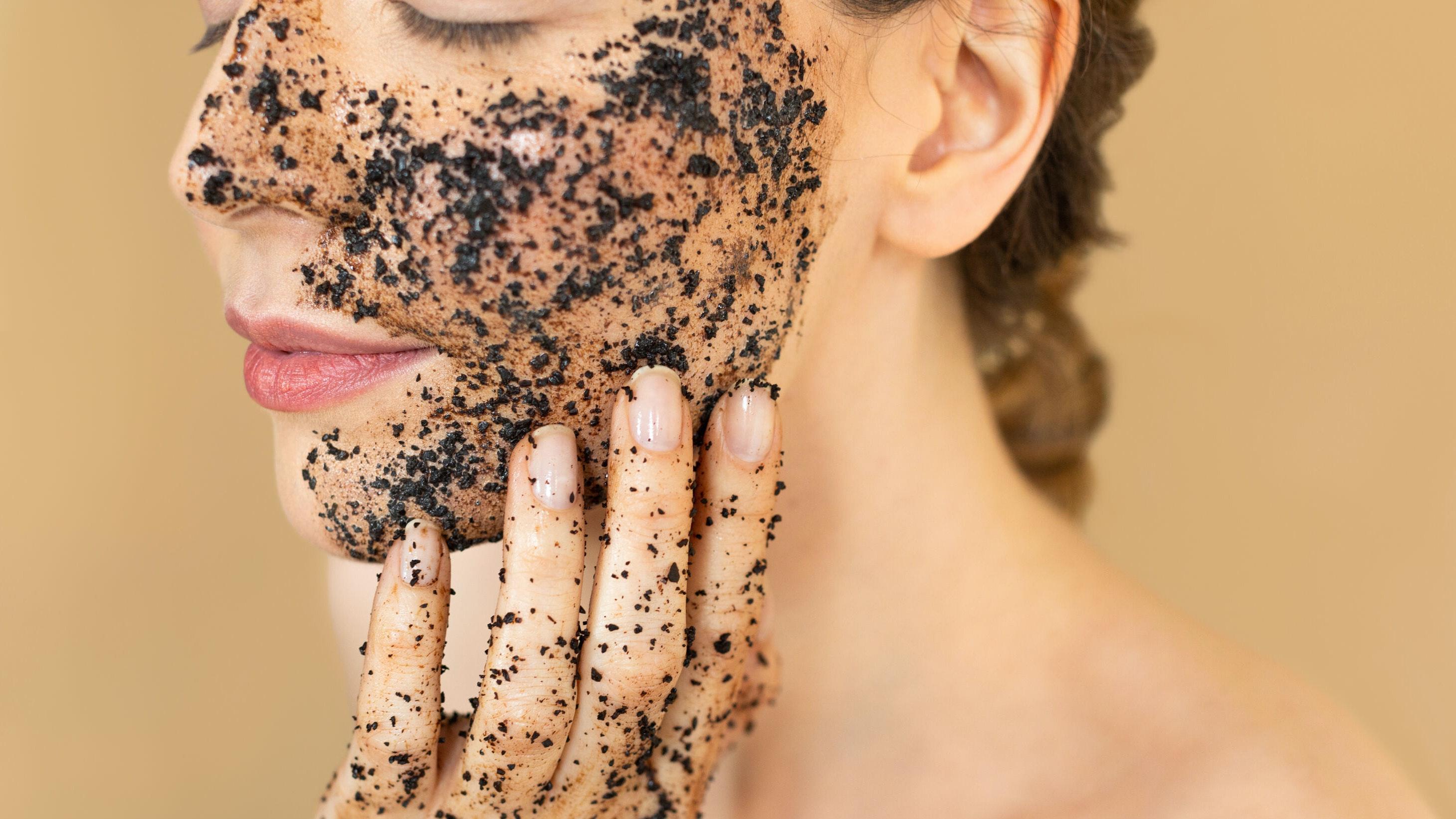 Woman Using Charcoal Face Scrub