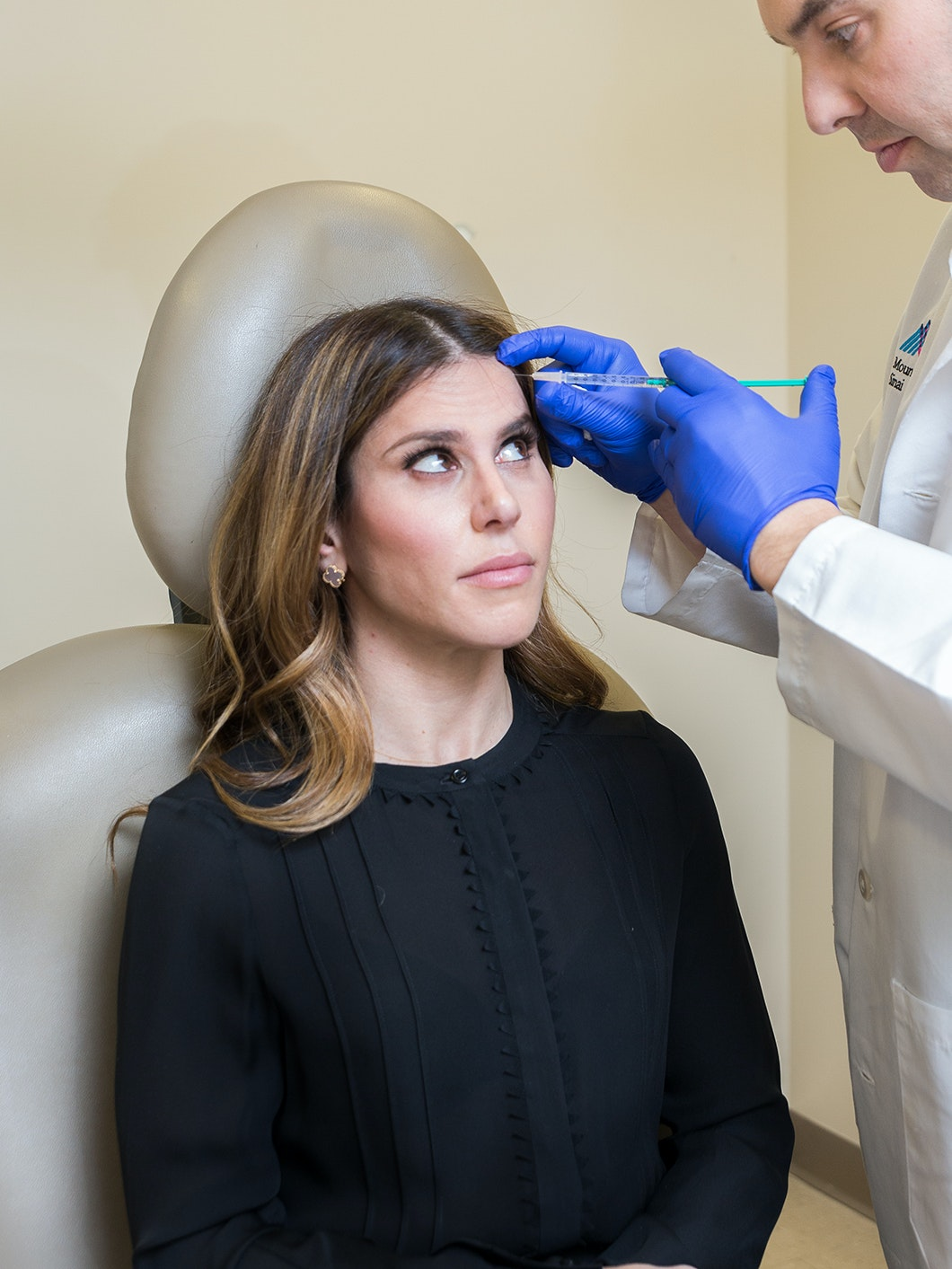 Woman getting injected in her forehead
