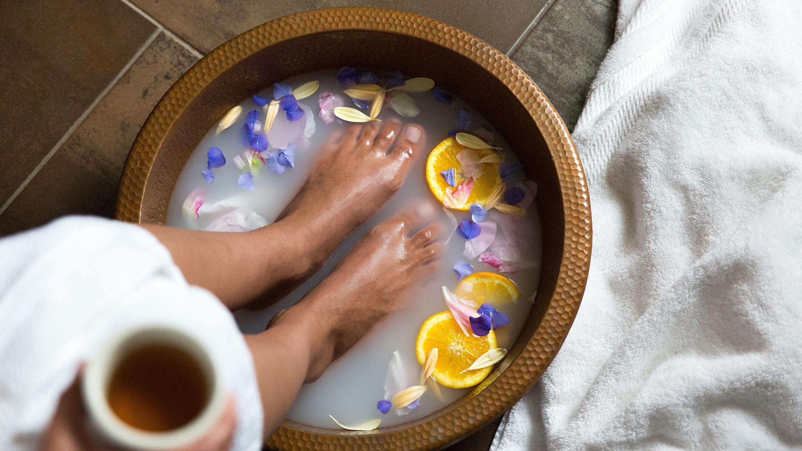 Woman soaking feet in dallas spa
