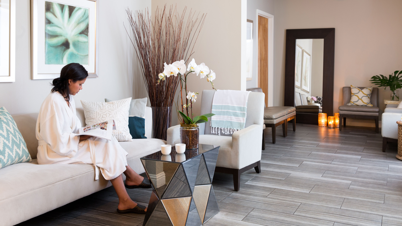 Woman sitting in robe at Hiatus Spa + Retreat in dallas