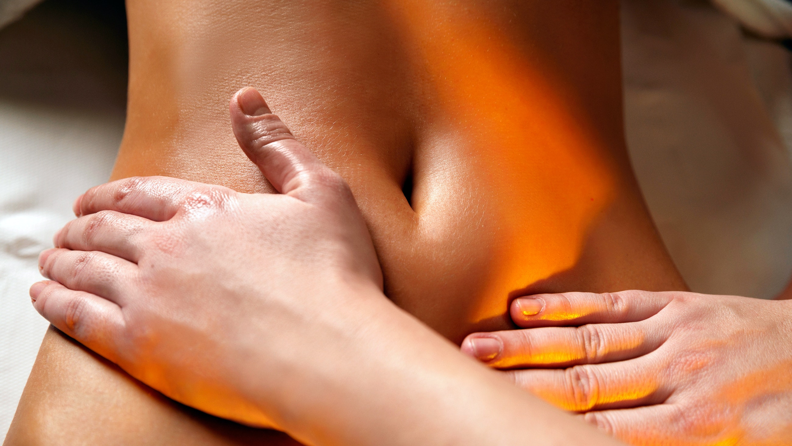 woman getting lymphatic drainage massage on stomach