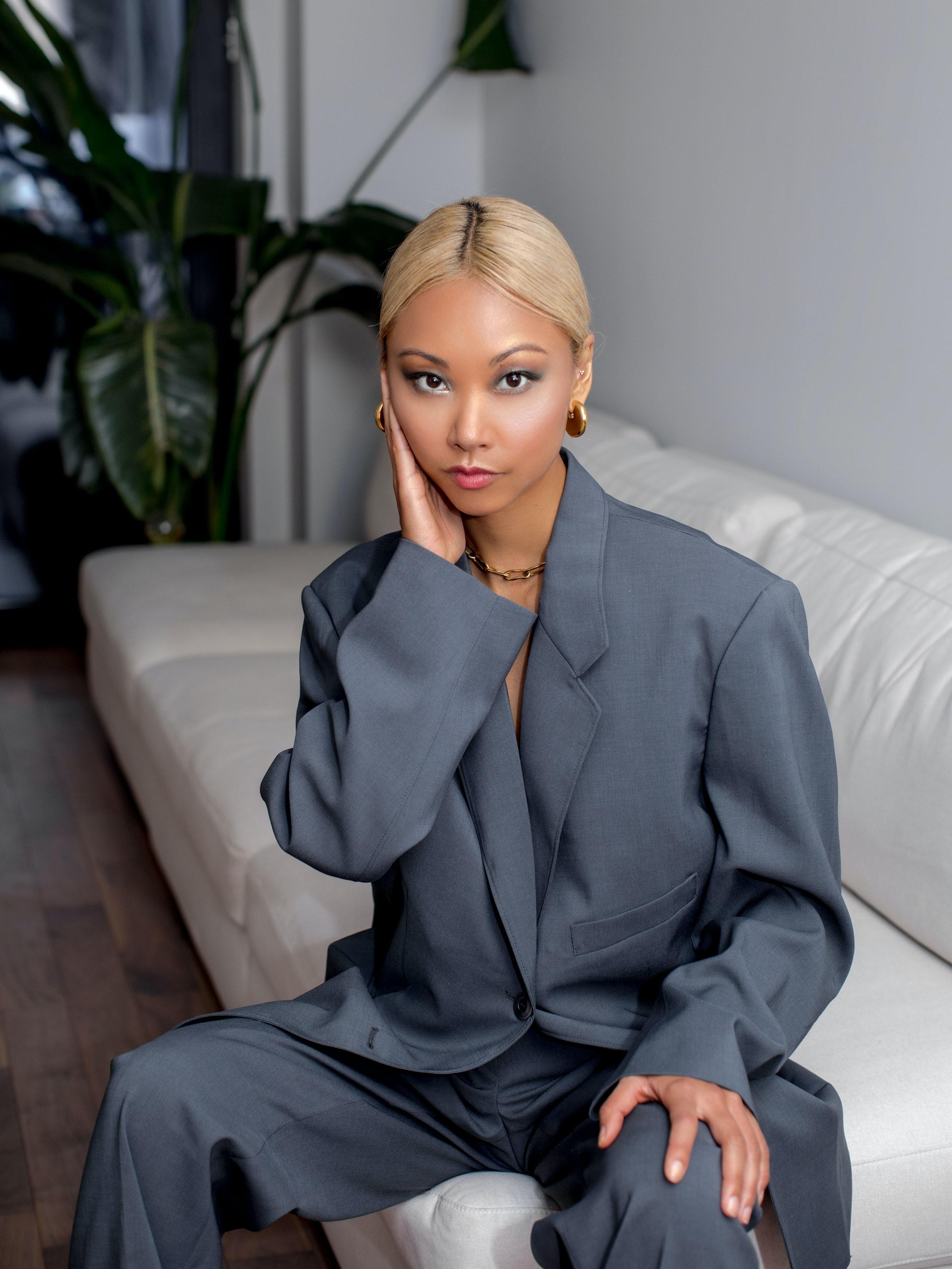 Vanessa Hong wearing grey Dior suit