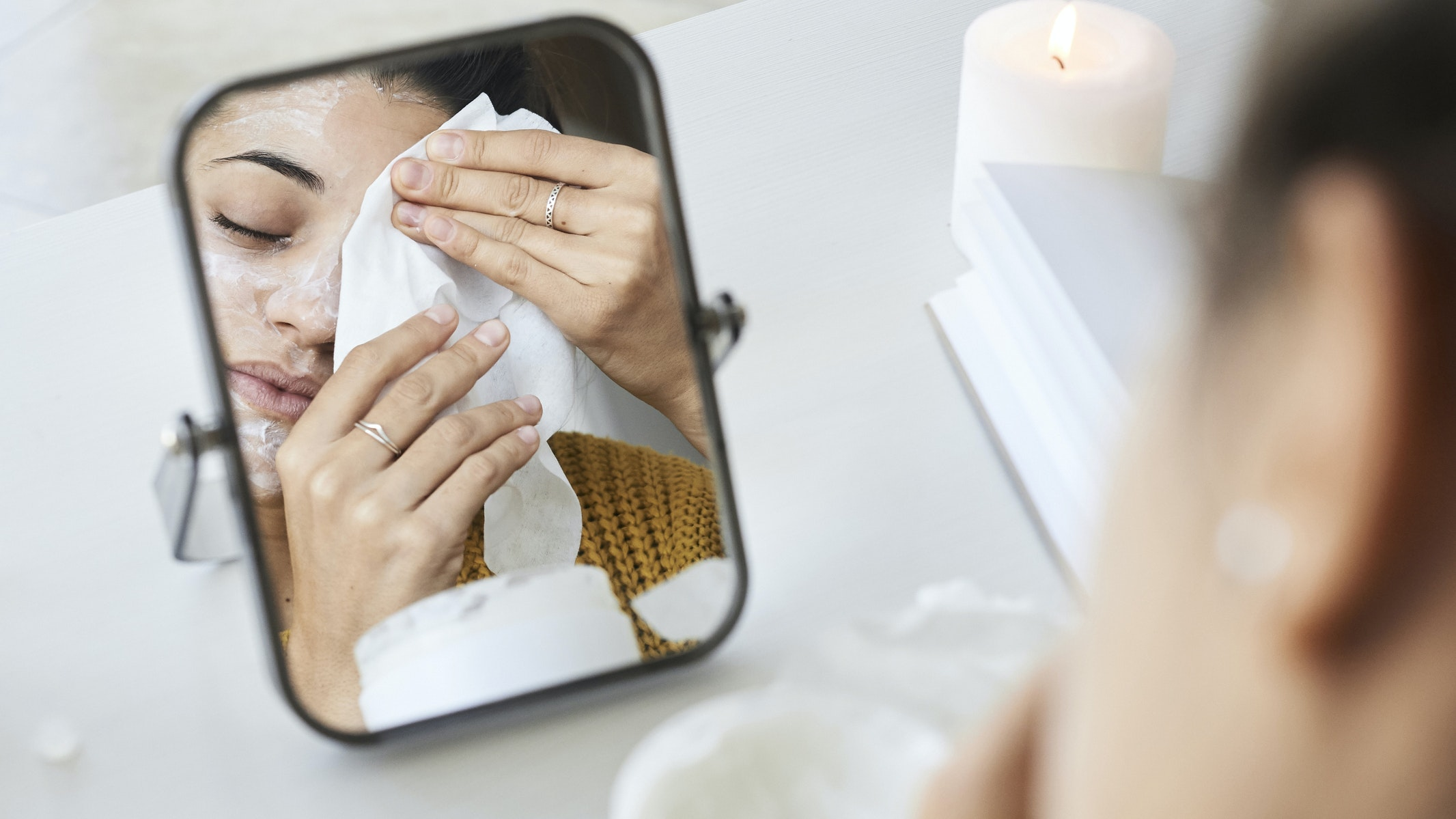 woman removing makeup with wipe