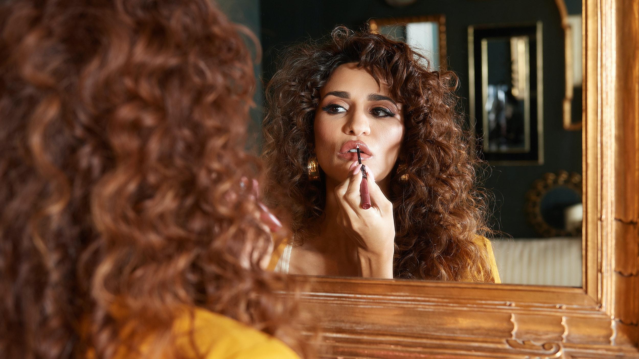 Fazia applying lipstick