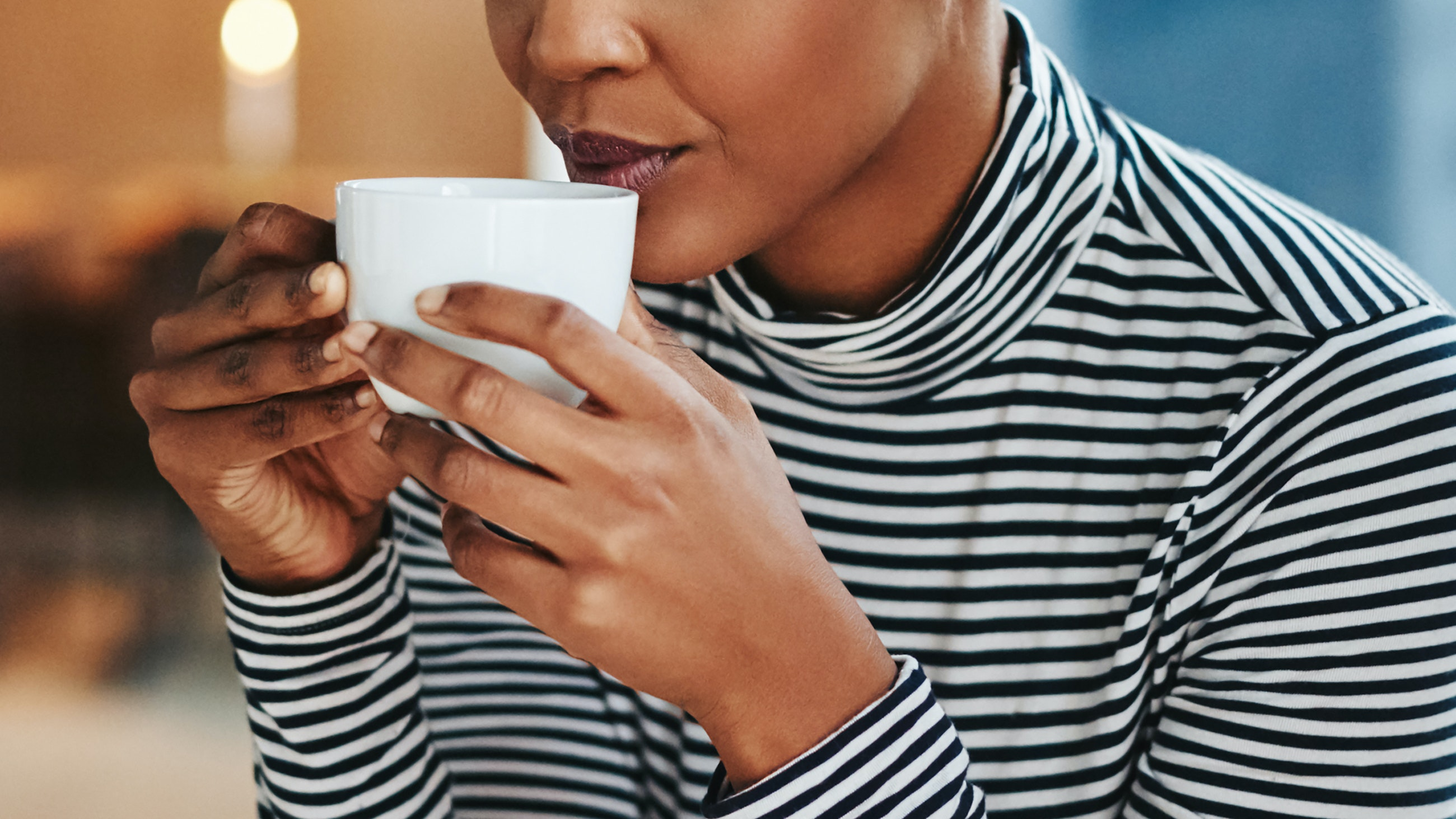 woman drinking coffee does coffee cause acne