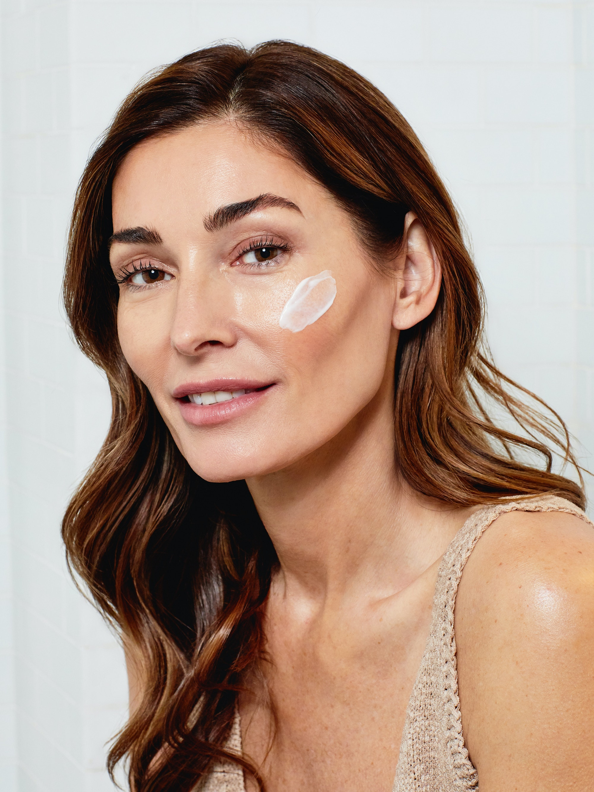 do you need to wear sunscreen in the winter woman with spf on face