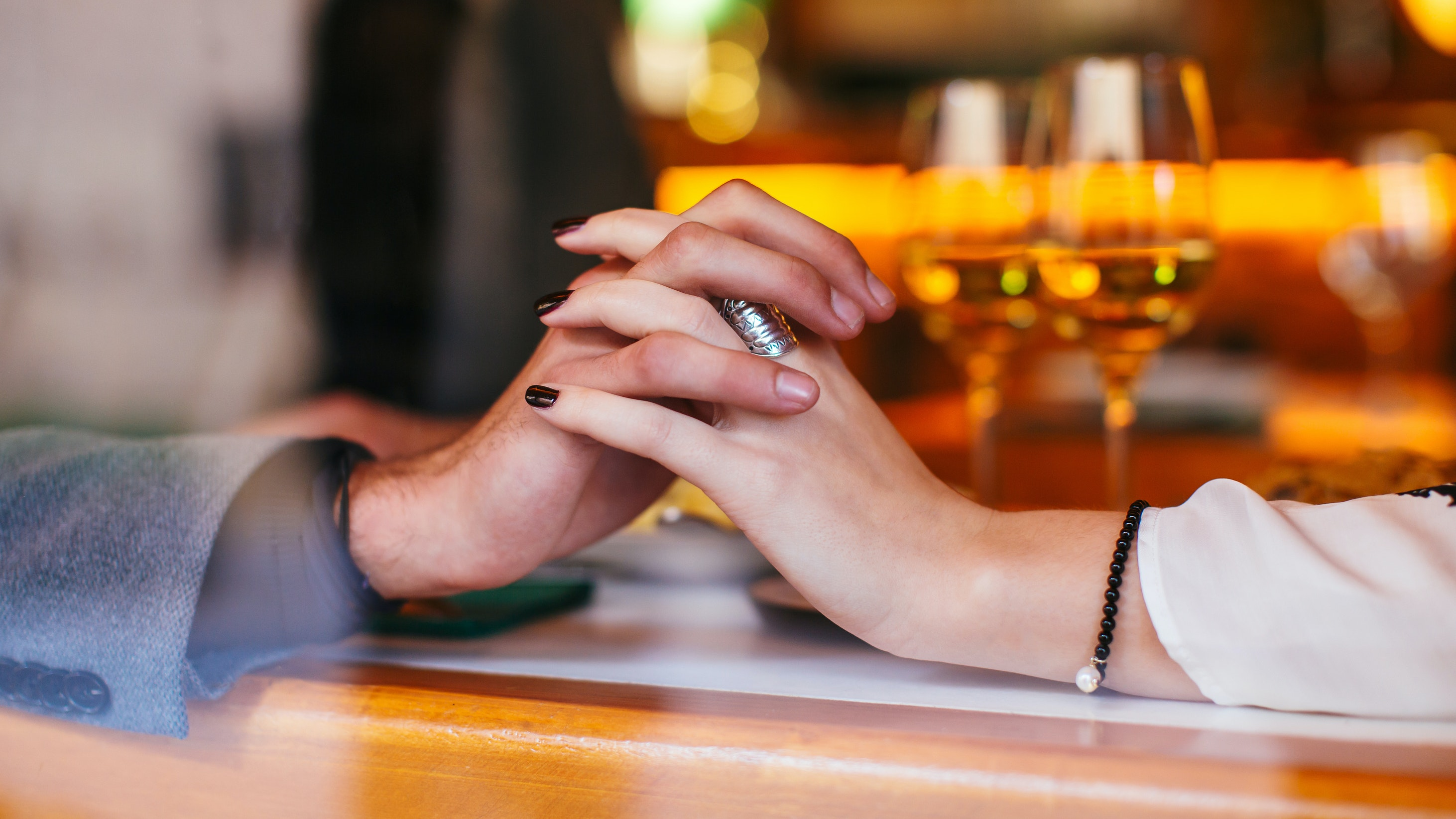 couple holding hands for date night