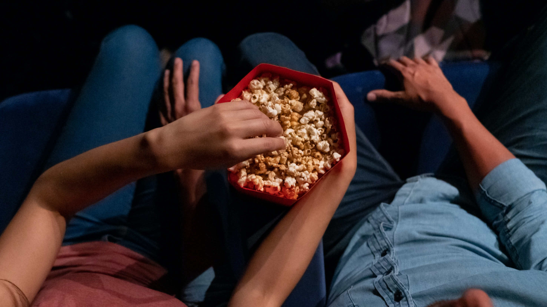 couple date night eating popcorn
