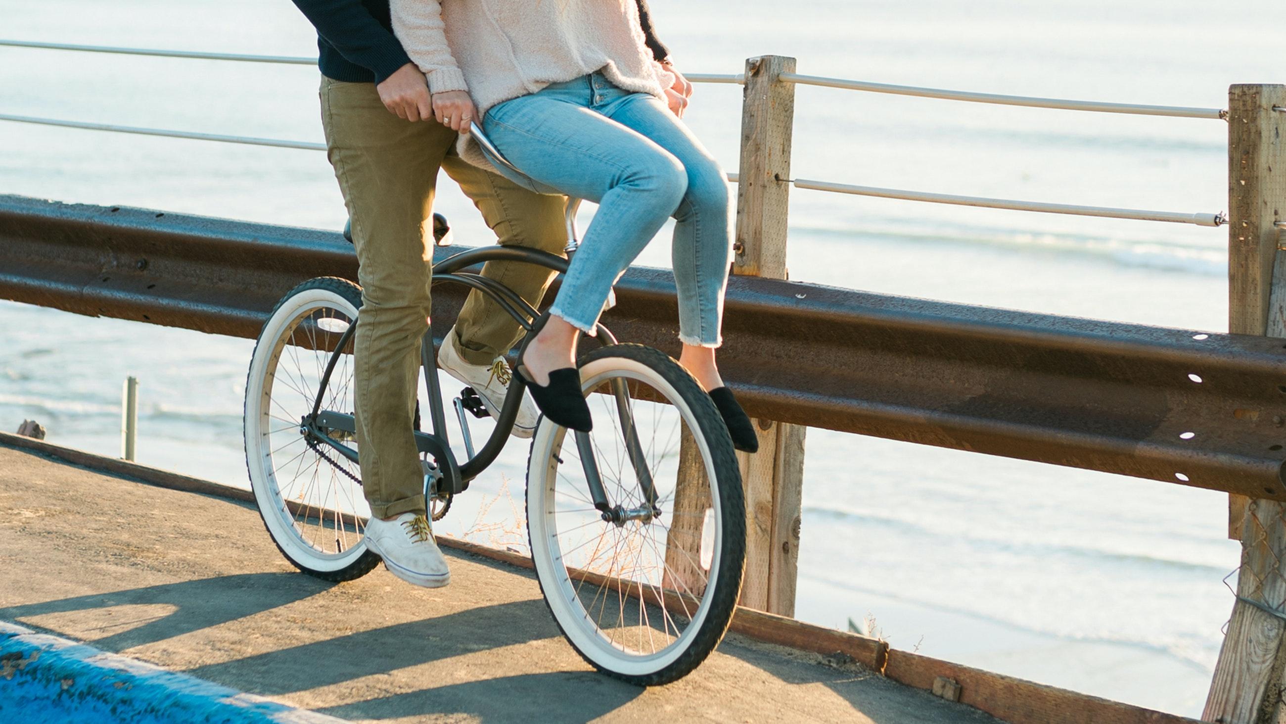 date night couple riding a bike