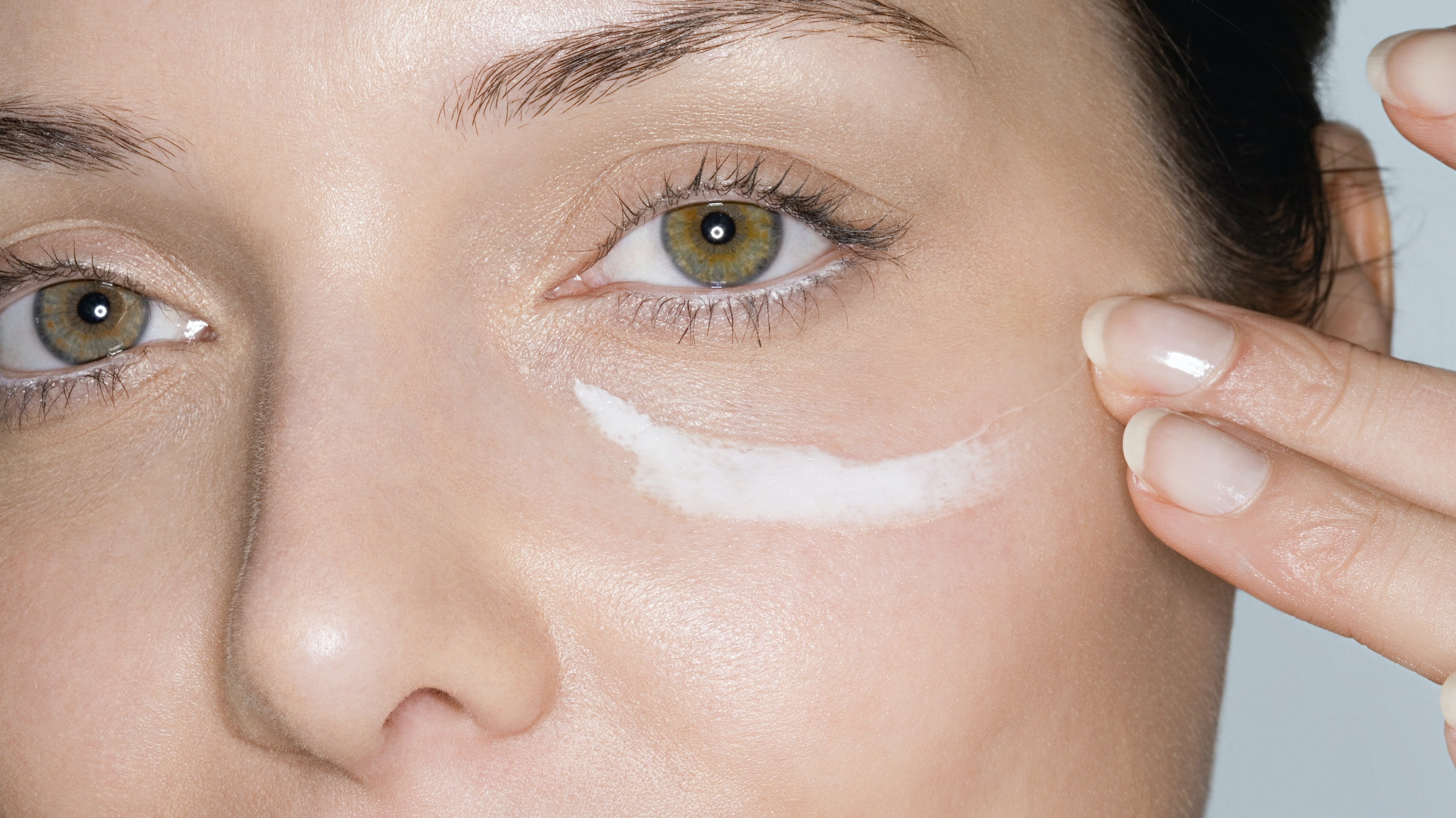 womans face with moisturizer