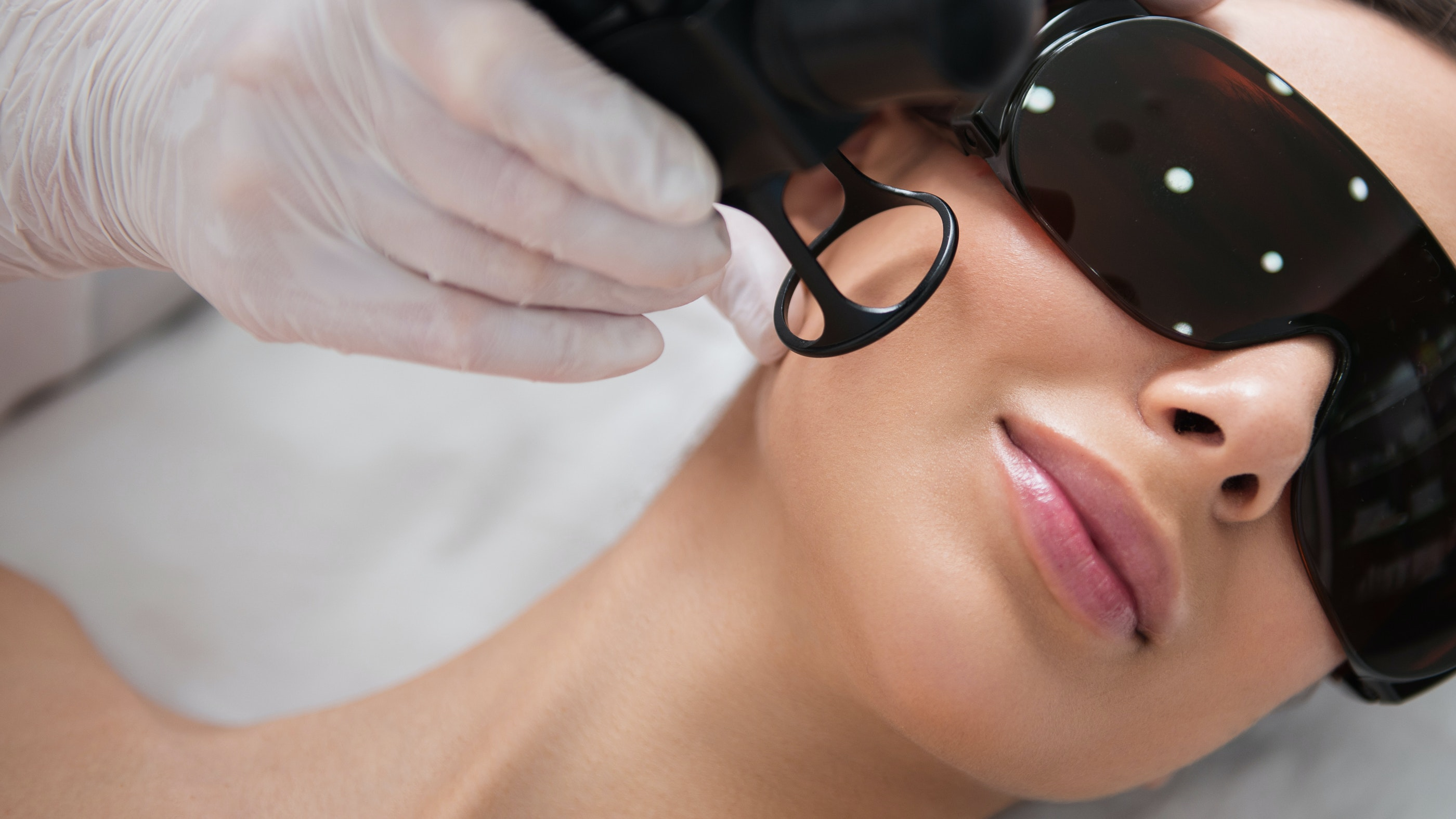 womans face during laser skin treatment