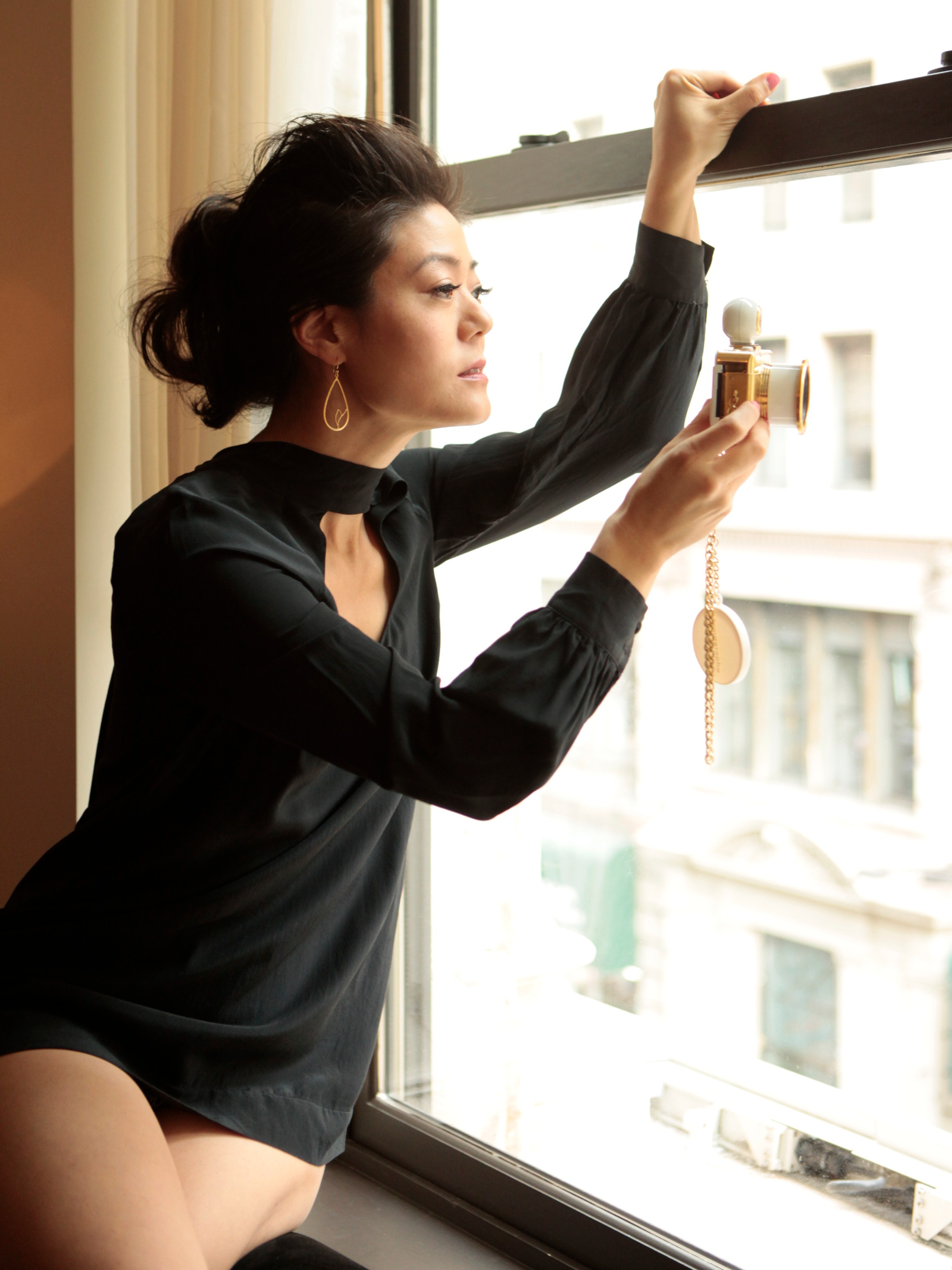 savor beauty founder angela jia kim looking out a window