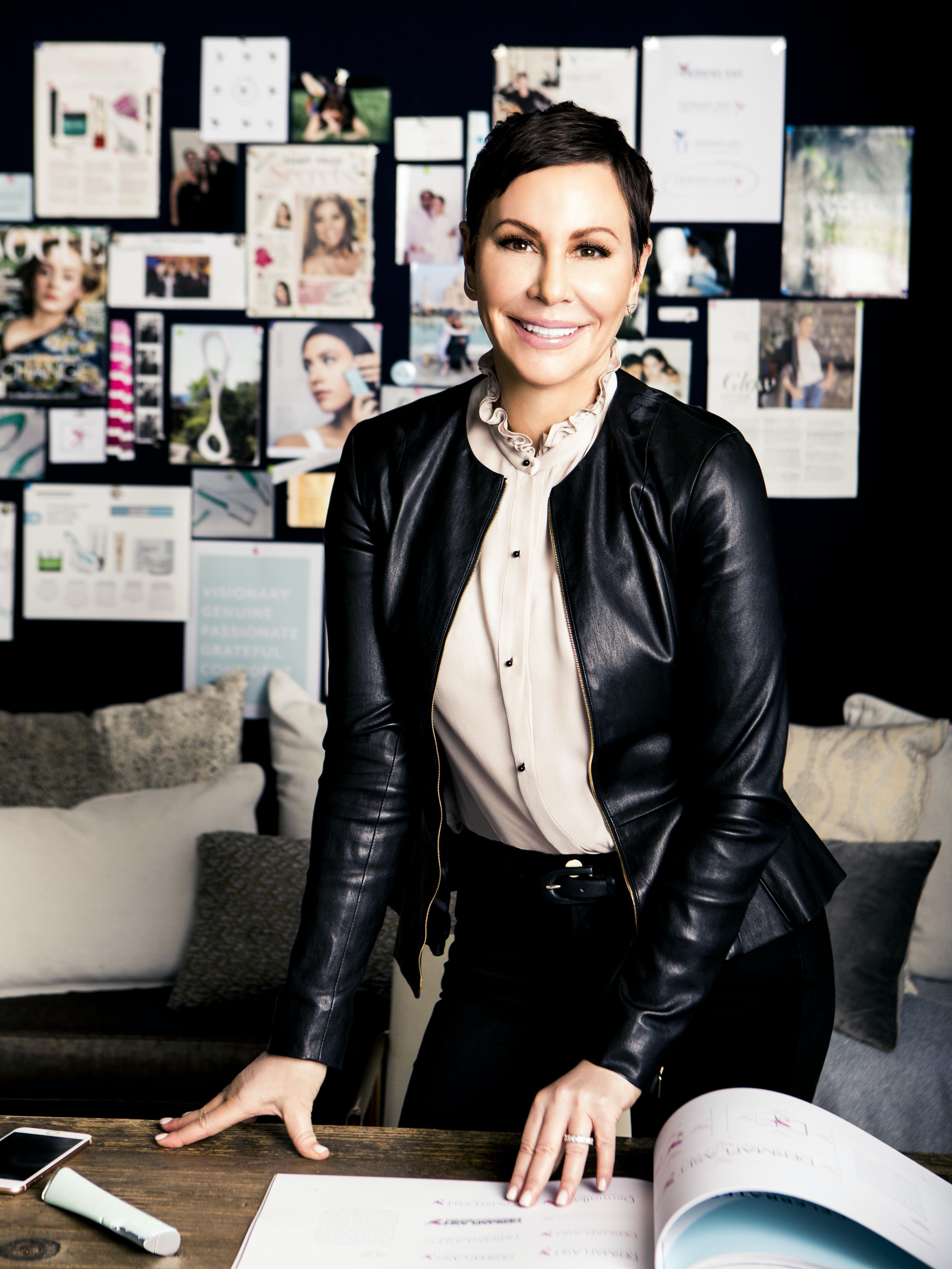 DERMAFLASH Founder Dara Levy in office