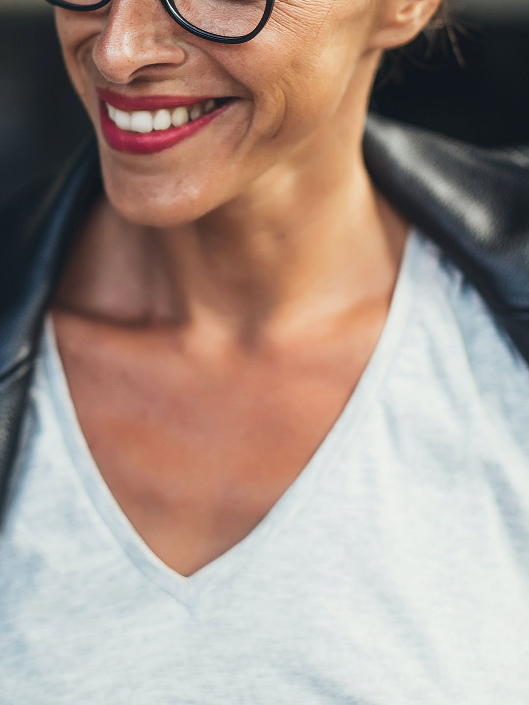 smiling woman's face and neck nasolabial folds