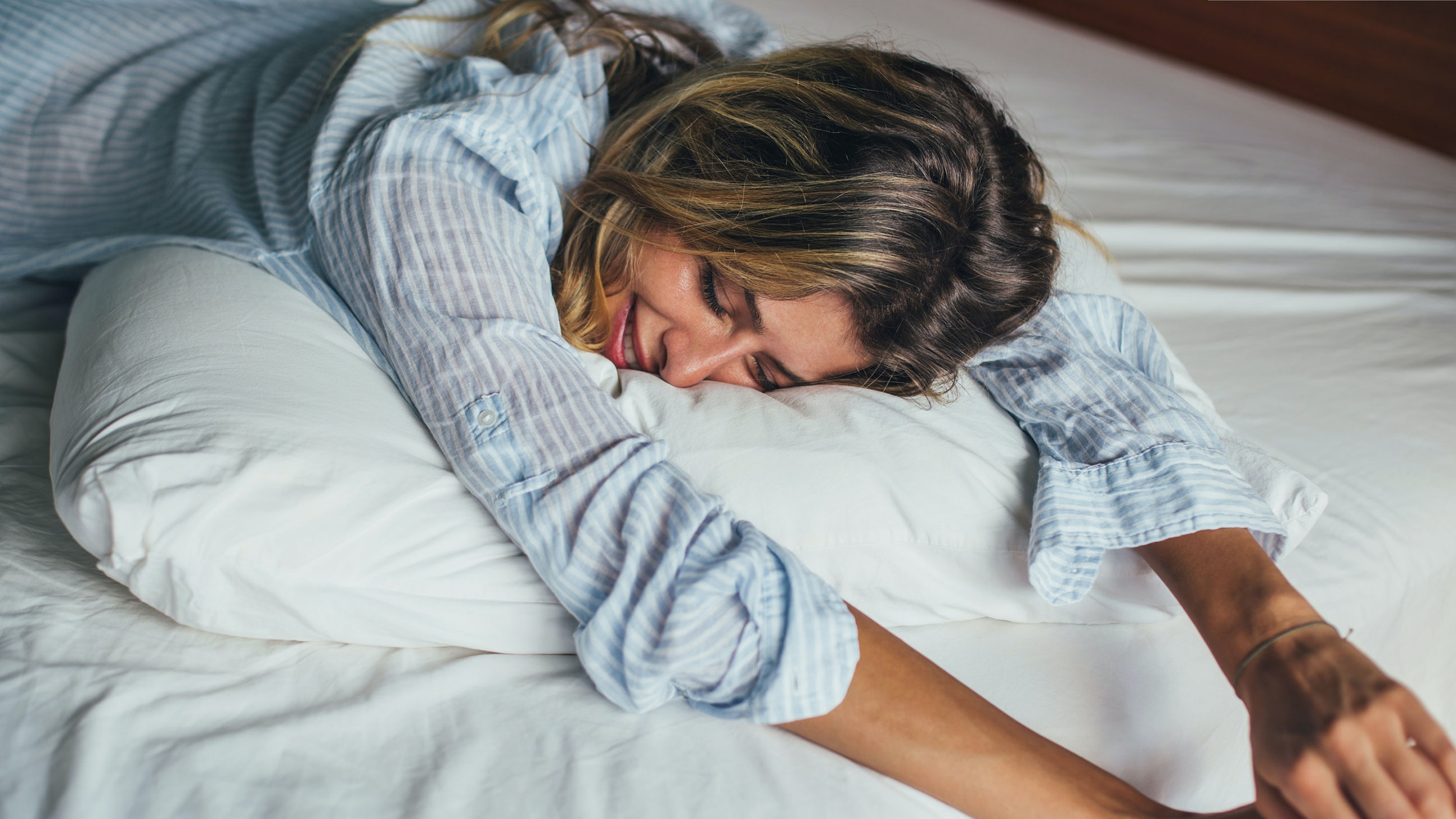 woman smiling on pillow
