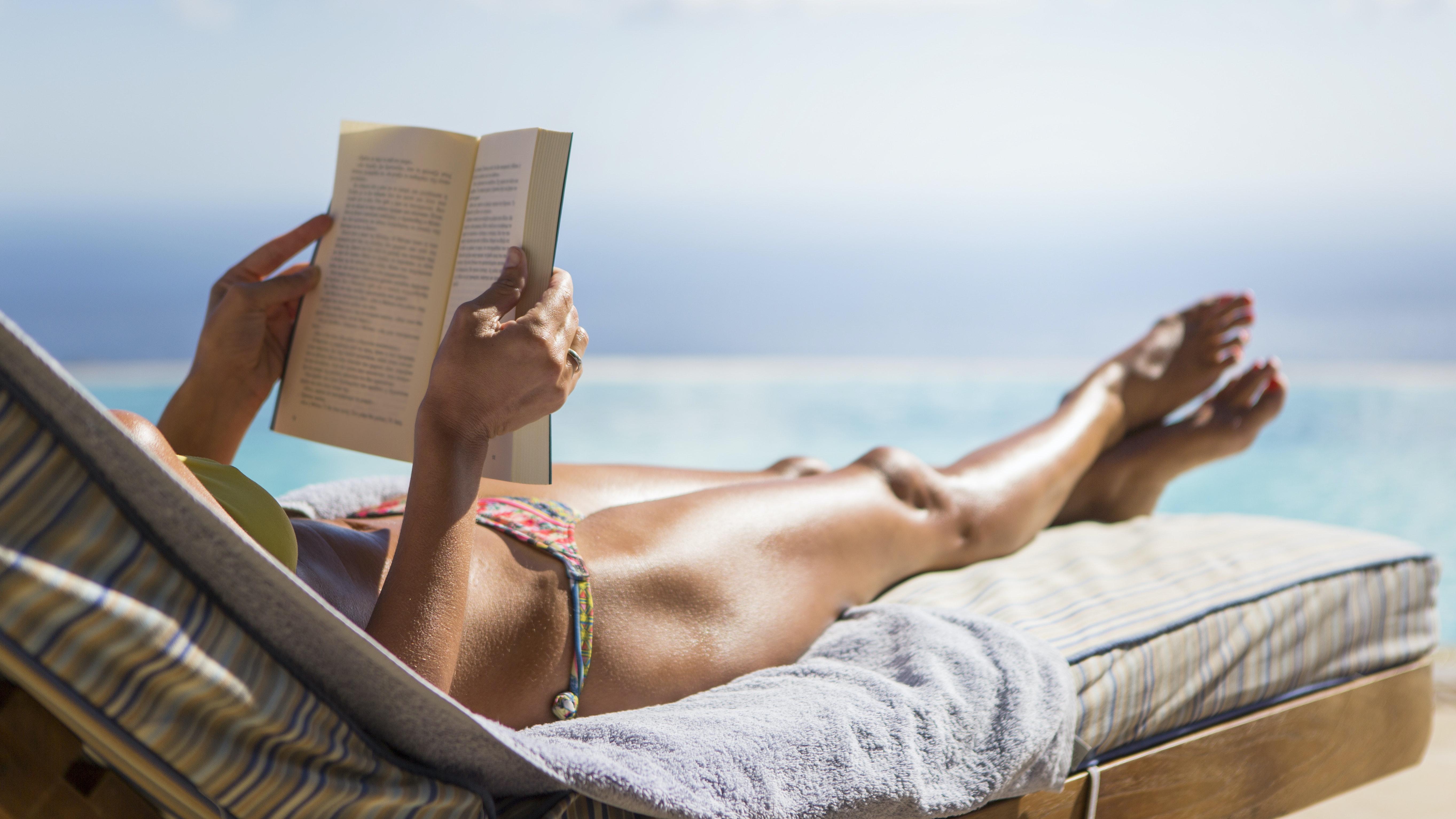 woman on beach sunscreen spf sun protective clothing