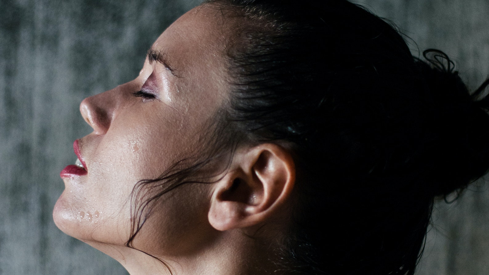 womans face steaming for clogged pores