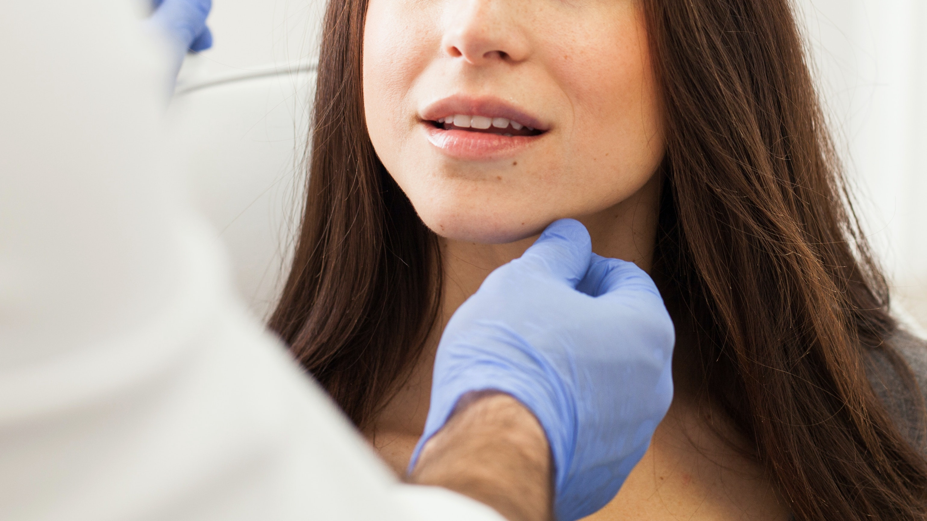 Woman getting injectables at doctor