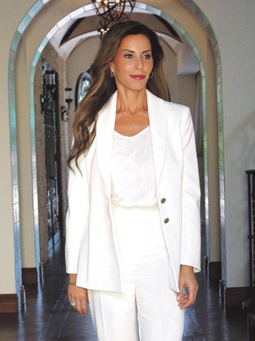 Karisma Skincare CEO Lisa Mazzarella all white suit