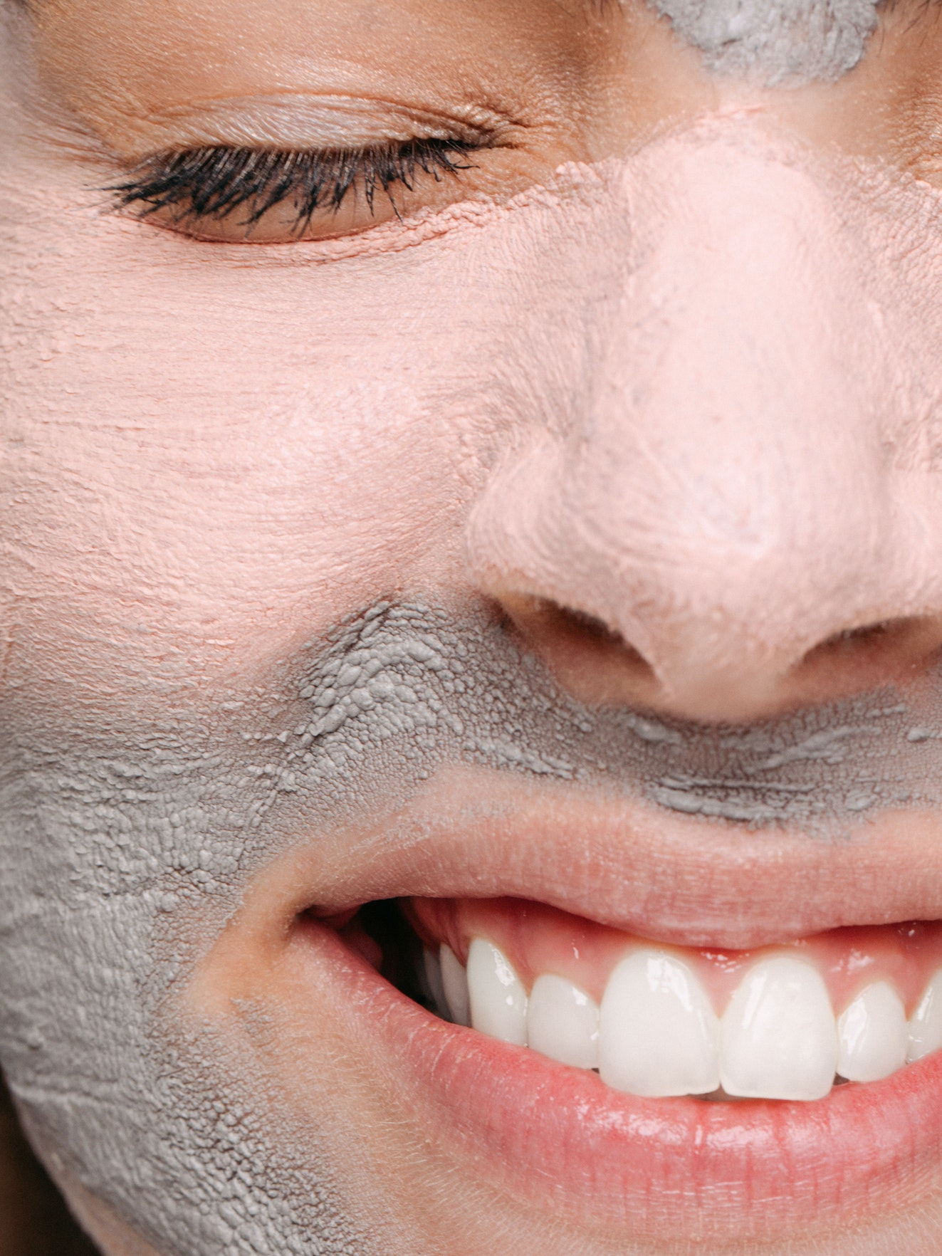 skincare with face mask close up to womans face
