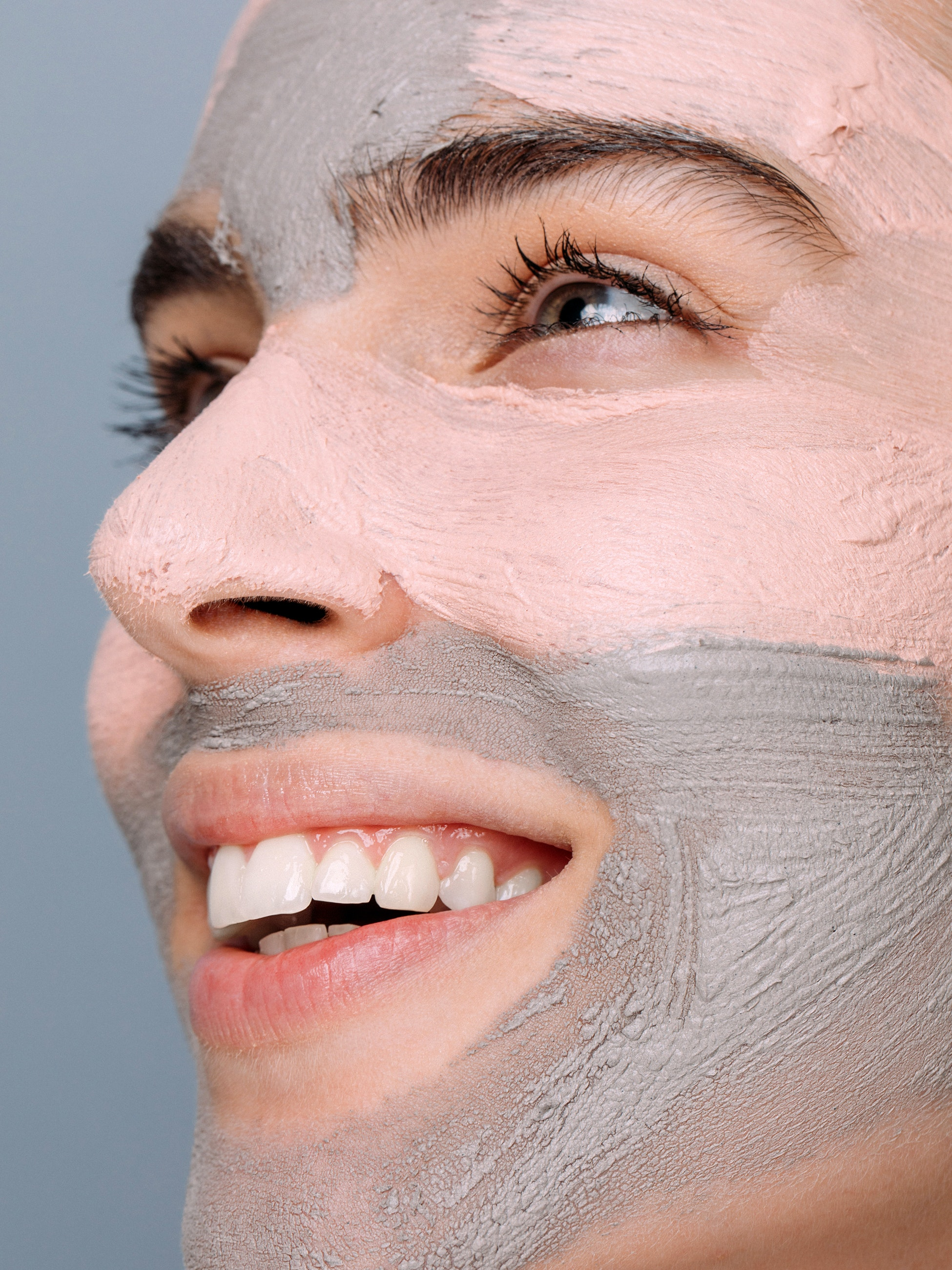 skincare with face mask close up to womans T zone  | Spotlyte