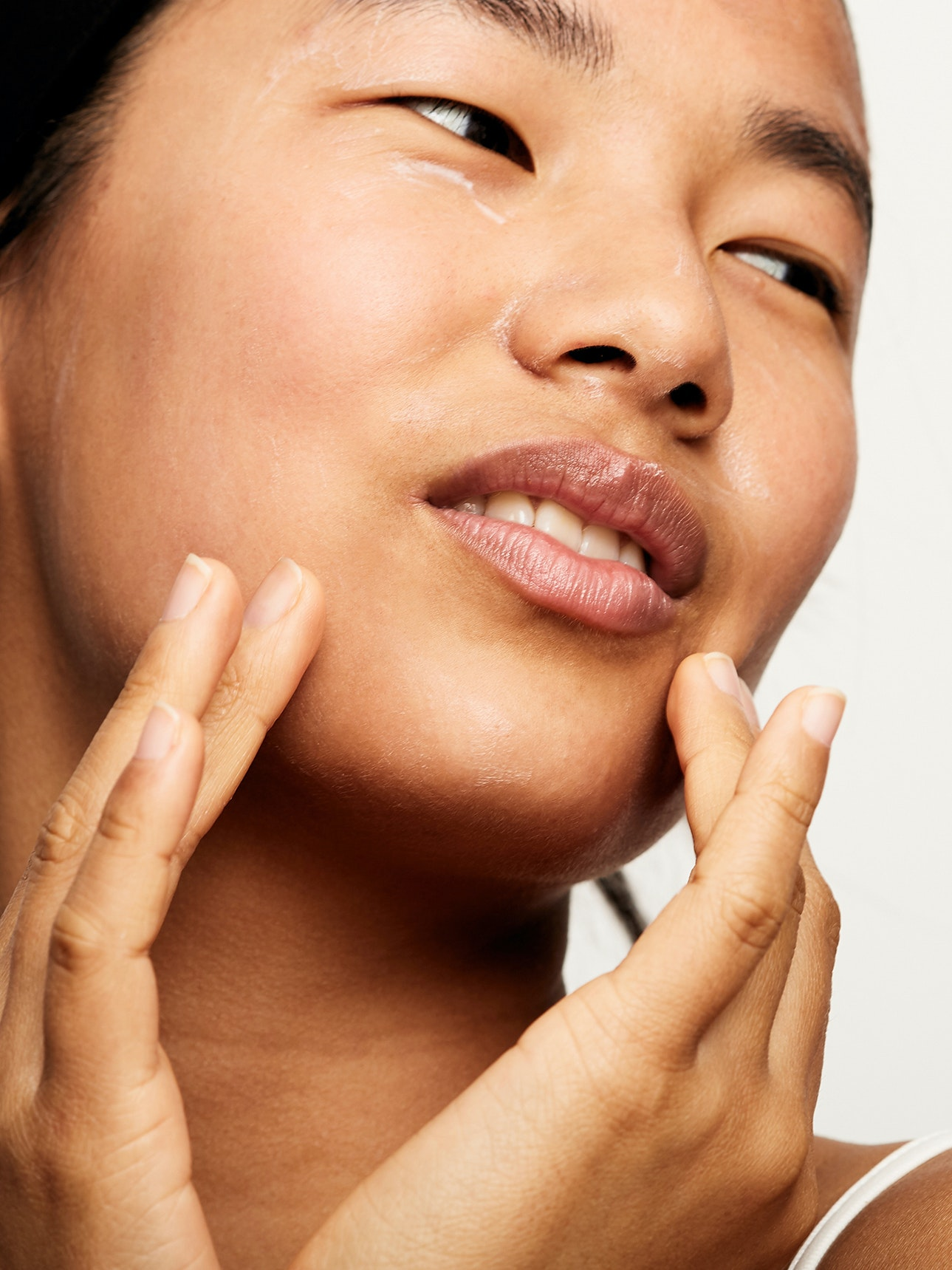 woman touching face skincare