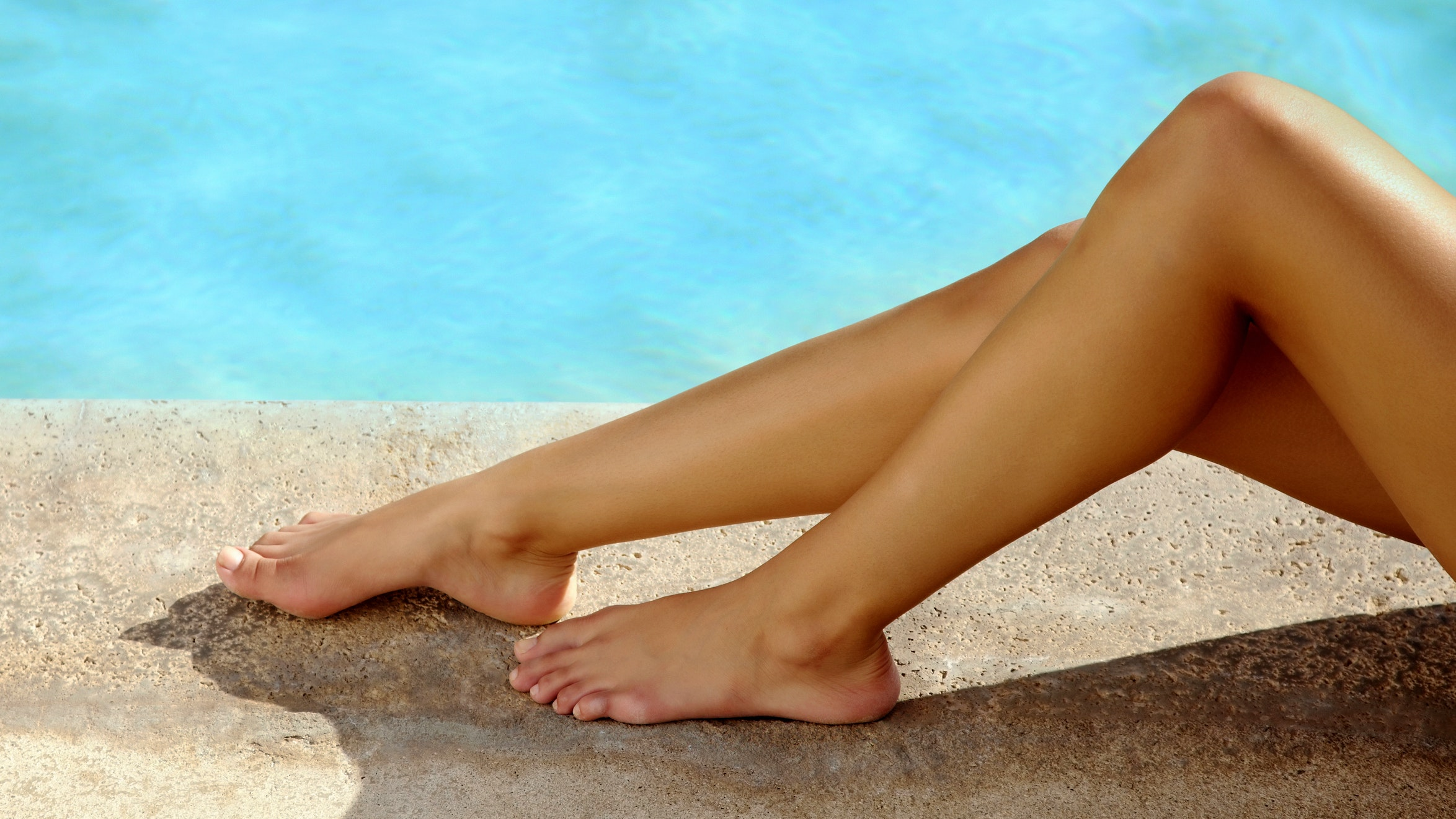womans legs by the water best self tanner exfoliating self tanner pads