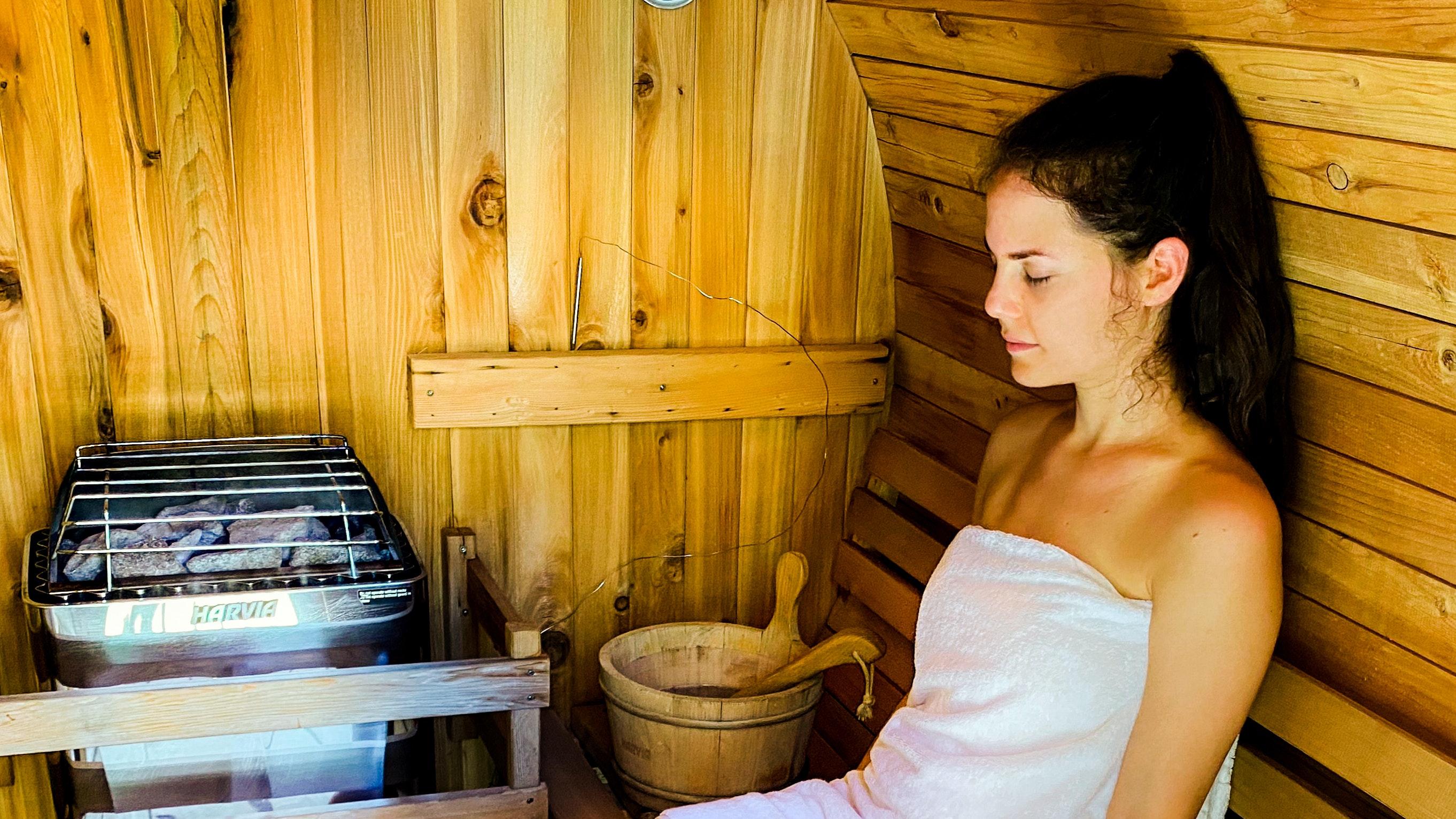 Sitting inside the barrel sauna