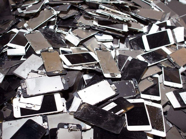 A pile of discarded, old smartphones and parts