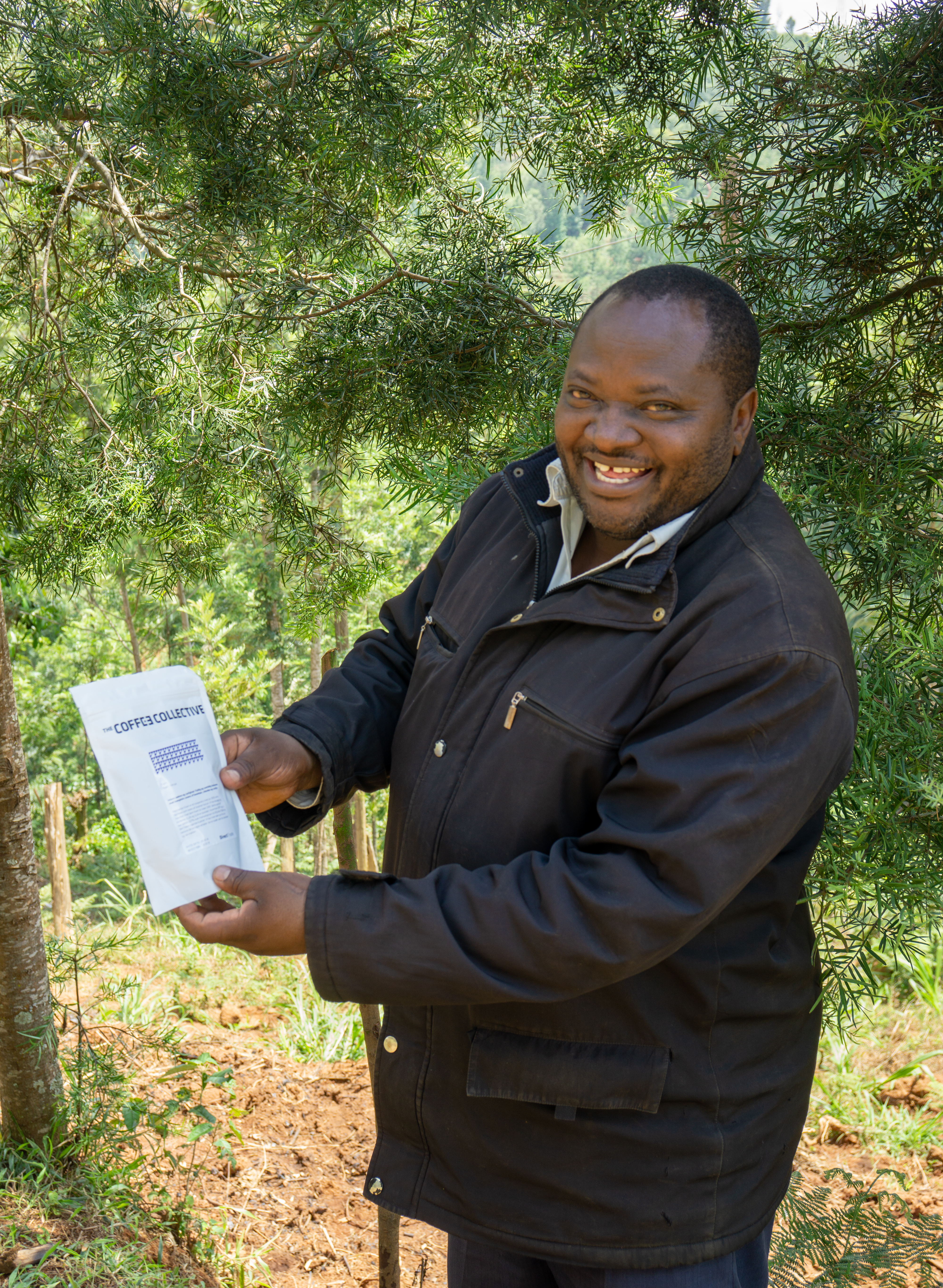 Kieni farmer Paul Mugo Waithaka is very happy to get a bag of his own coffee